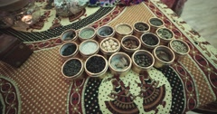 Close up pan view of Indian spices  in identical cups at Indian market.dolly Stock Footage