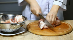 a cook cuts the raw meat - stock footage