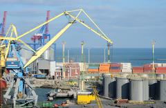 Stock Photo of Odessa cargo port with grain dryers,transport containers and colourful cranes