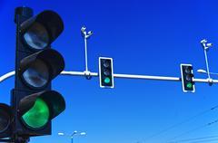 Traffic lights over blue sky - stock photo