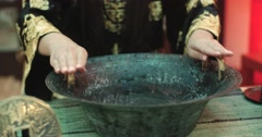 Beautiful Chinese girl uses a magic singing bowl with  boiling water effect Stock Footage