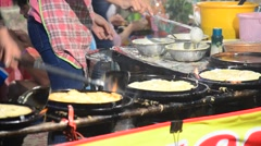 Thai people cooking Fried mussel with egg and crispy flour or Oyster omelette - stock footage