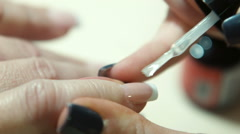 The master varnishes nails Stock Footage