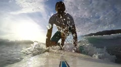 Surfing at sunset cinemagraph Stock Footage