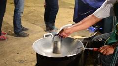 Thai people cooking snack called Khanom La Stock Footage