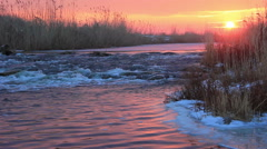 Dawn over Rushing winter river Stock Footage