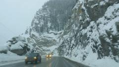Winter driving with traffic in the Rockies. HWY 1 in BC, Canada. Stock Footage