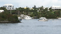 Houses on the hills behind Hamilton, Bermuda, seen from the sea  Stock Footage