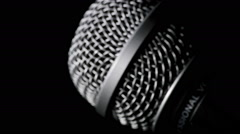 Radio microphone gyrating at black background - stock footage