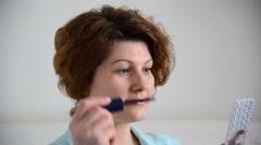 Lash mascara for eyelashes, woman applying make up - stock footage