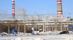 Thermal power plant in sunny cold day. Industrial smoke from the pipes against Stock Footage