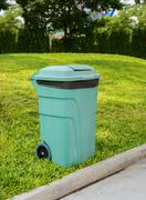 Green Wheelie Bins for General Waste and Garden Organics - stock photo