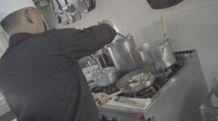 Thai cook preparing food on a stove, ungraded, slog2 - stock footage