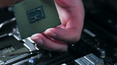 Cpu in hand and motherboard for a home computer Stock Footage