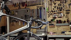 In bicycle's workshop. Slider shoot Stock Footage