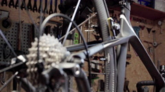 Close view of bicycle in workshop. Close up. Stock Footage