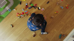 Children Playing With Building Blocks At Home Stock Footage