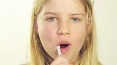 Girl brushing her teeth Stock Footage