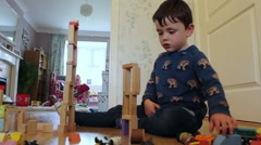 Children Playing With Building Blocks At Home - stock footage