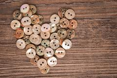 Valentine heart buttons textiles - stock photo