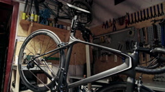 Close view of bicycle in workshop. Close up. Slider shoot Stock Footage