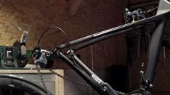 Mechanic repairing bicycle in workshop. Slider shoot Stock Footage