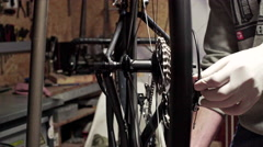 Mechanic repairing bicycle in workshop. Close up. Slider shoot Stock Footage