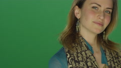 Beautiful woman being flirty, on a green screen studio background - stock footage