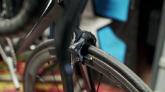 Mechanic repairing bicycle in workshop. Close up Stock Footage