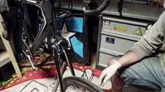 Mechanic repairing bicycle in workshop. Slider shoot Stock Footage