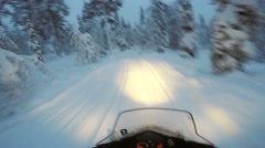 Snowmobile skidoo speeding through snowy forest Stock Footage
