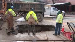 Workers Standing around Water Main Break - hole Stock Footage