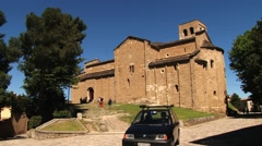 People visit medieval San Leo cathedral in San Leo, Italy. Stock Footage