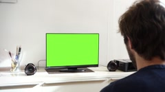 Young Man Watching Television Green Screen in Living Room Stock Footage