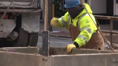 Water Main Break - Workers move box in place Stock Footage