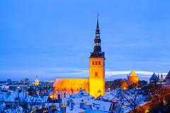 Panoramic view of old part of Tallin in winter. Niguliste church at night - stock photo
