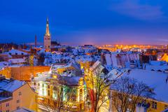 Panoramic view of old part of Tallin in winter. Oleviste and old harbor - stock photo
