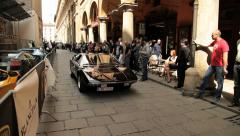 People watch classic Lamborghini car passing by the street in Bologna, Italy. Stock Footage