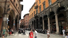 People walk by the square in Modena, Italy. Stock Footage