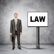 Businessman word law on post sign - stock photo