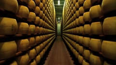 View to the cheese-wheels of parmesan maturing at the cellar. Stock Footage