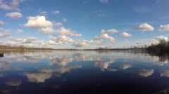 Perfect clouds and blue sky reflection in great lake Stock Footage