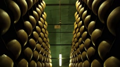 Stock Video Footage of View to the cheese-wheels of parmesan maturing at the cellar.