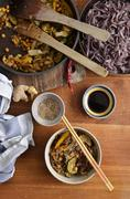Plan portrait view of stir fried vegetables with black rice noodles, served i - stock photo