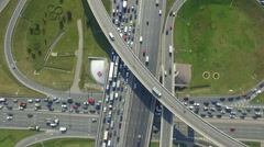 Aerial view over crossed roads and grade-crossing elimination structure Stock Footage