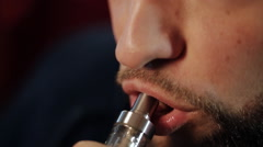 Man Exhaling smoke from a vaporizer Stock Footage