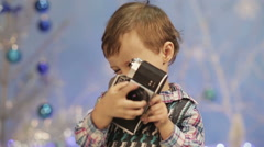 Little boy with old camera - stock footage