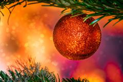 Glittering Christmas bauble in red color - stock photo