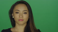 Beautiful young woman giving attitude, on a green screen background - stock footage