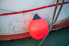 Orange buoy on a fishing boat Stock Photos